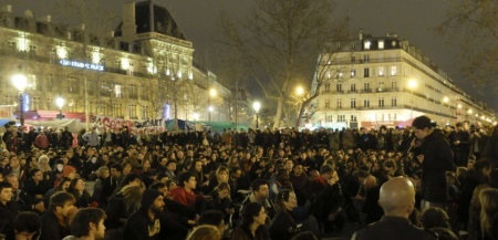 "A crowd listen to a woman during a gathering on the Place de la Republique Sunday, April 3, 2016 in Paris. A few hundred protesters have been camping out, holding night-time demonstrations since last week at a symbolic rallying point on the Place de la Republique, to express anger at a proposed labor law that would extend the workweek and make layoffs easier. The social media-driven movement, called ""Nuit Debout"" or ""Rise up at Night,"" sprang from nationwide strikes and protests Thursday. (AP Photo/Bertrand Combaldieu)/NYOTK/337703773697/ /1604041110"